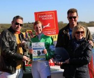 Hannah and Bracken's joint owners collecting their prizes after their win